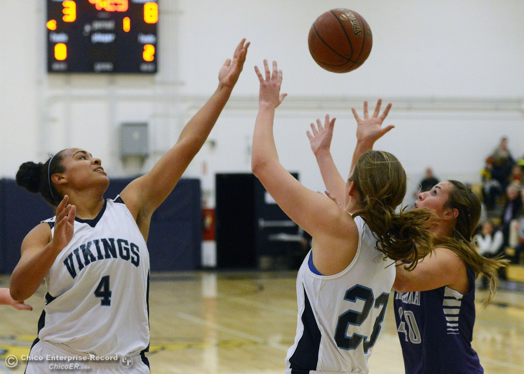 . Pleasant Valley High\'s #4 Dominique Jackson (left) and #23 McKena Barker (center) attempt a rebound Petaluma High\'s #40 Joelle Krist (right) in the first quarter of their girls basketball game at PVHS Varley Gym Friday, December 6, 2013 in Chico, Calif. (Jason Halley/Chico Enterprise-Record)