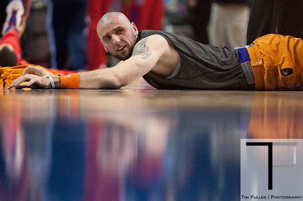 Nov 28, 2012; Auburn Hills, MI, USA; Phoenix Suns center Marcin Gortat (4) stretches before the game against the Detroit Pistons at The Palace. Mandatory Credit: Tim Fuller-USA TODAY Sports