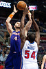Nov 28, 2012; Auburn Hills, MI, USA; Detroit Pistons power forward Jason Maxiell (54) guards Phoenix Suns center Marcin Gortat (4) during the first quarter at The Palace. Mandatory Credit: Tim Fuller-USA TODAY Sports