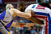 Nov 28, 2012; Auburn Hills, MI, USA; Phoenix Suns center Marcin Gortat (4) guards Detroit Pistons center Greg Monroe (10) during the third quarter at The Palace. Detroit won 117-77. Mandatory Credit: Tim Fuller-USA TODAY Sports