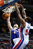Nov 28, 2012; Auburn Hills, MI, USA; Detroit Pistons power forward Jason Maxiell (54) slam dunks over Phoenix Suns center Marcin Gortat (4) during the third quarter at The Palace. Detroit won 117-77. Mandatory Credit: Tim Fuller-USA TODAY Sports
