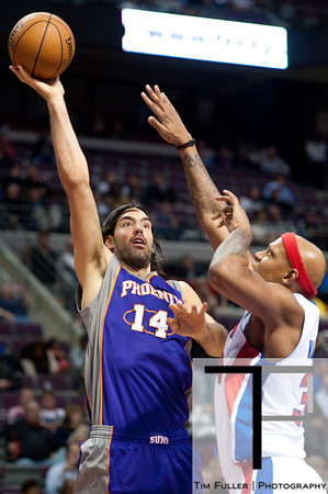 Nov 28, 2012; Auburn Hills, MI, USA; Detroit Pistons small forward Corey Maggette (50) guards Phoenix Suns power forward Luis Scola (14) during the second quarter at The Palace. Mandatory Credit: Tim Fuller-USA TODAY Sports