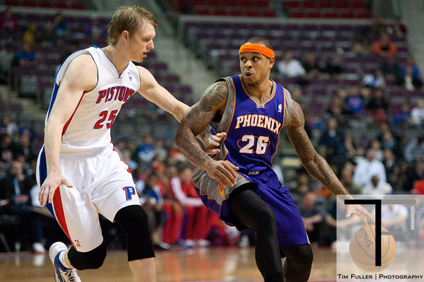 Nov 28, 2012; Auburn Hills, MI, USA; Phoenix Suns point guard Shannon Brown (26) drives to the basket against Detroit Pistons small forward Kyle Singler (25) during the first quarter at The Palace. Mandatory Credit: Tim Fuller-USA TODAY Sports