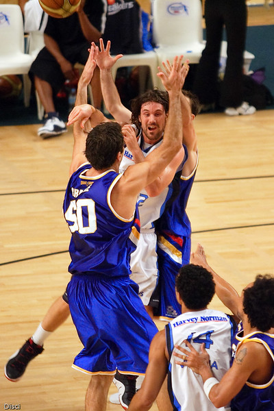 Aaron Olson passes out of the double-team. Brisbane Bullets v New Zealand Breakers Retro Night, 3 February 2007