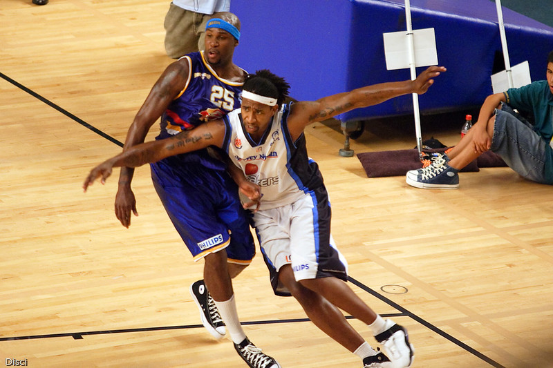 Carlos Powell tries to get post position on Ebi Ere. Brisbane Bullets v New Zealand Breakers Retro Night, 3 February 2007