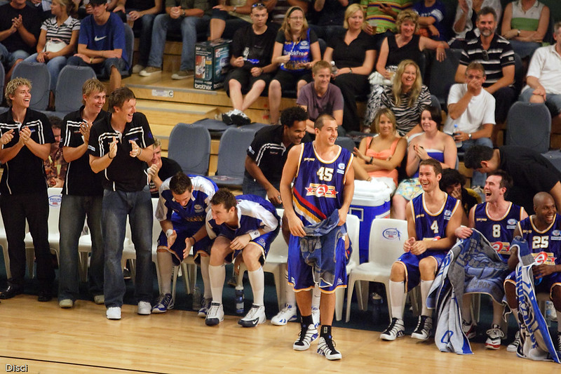 Bullets impressed by Mark Bradtke's behind-the-back dribble on the layup. Brisbane Bullets v New Zealand Breakers Retro Night, 3 February 2007