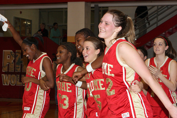 Lady Wolves celebrate their victory