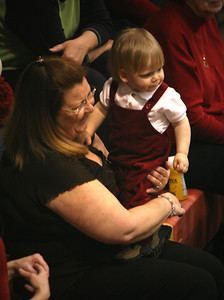 G'mama Michelle McDade cheers with grand son Ryan Strickland (18 months) at the Lady Wolves Game on Saturday night_RA