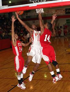 Rome #15 Terrell Burley slam dunks past Dalton's #24 Kareem Hawkins & #14 Shaquon Moore