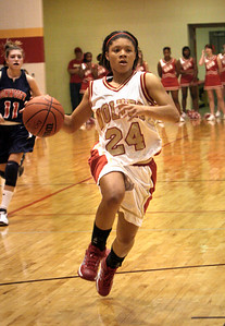 Rome's #24 Candace Foster takes the ball down the court past Dunwoody's #11 Christin Brower in Saturdays game at Rome High_RuthAnne Anderson