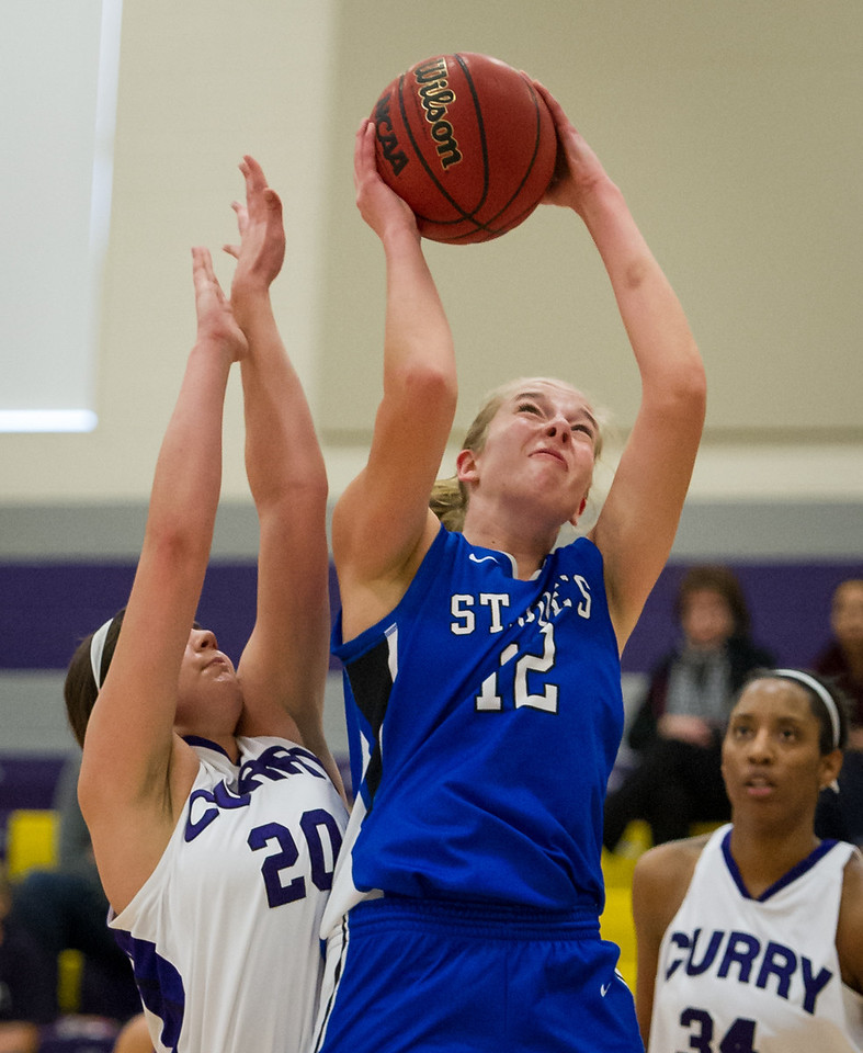 Abby Young (12) goes up strong for a shot during the Women's Basketball game between Saint Joseph's (ME) and Curry Collage at Curry College, Milton, Massachusetts, USA on November 16, 2013. Photo: Chris Poss