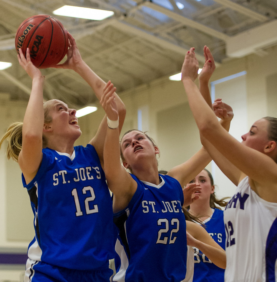 Abby Young (12) grabs a rebound during the Women's Basketball game between Saint Joseph's (ME) and Curry Collage at Curry College, Milton, Massachusetts, USA on November 16, 2013. Photo: Chris Poss