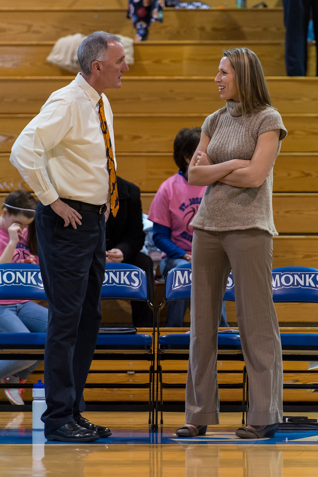 Head Coach Mike McDevitt and Assistant Coach Annie Hodgdon talk before the Women's Basketball game between Saint Joseph's (ME) and Emerson College at Saint Joseph's College, Standish, Maine, USA on February 16, 2013. Photo: Chris Poss