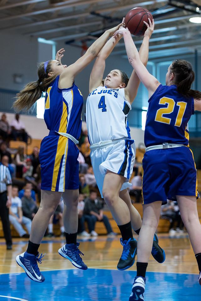 Skyler Makkinje (4) during the Women's Basketball game between Saint Joseph's (ME) and Emerson College at Saint Joseph's College, Standish, Maine, USA on February 16, 2013. Photo: Chris Poss