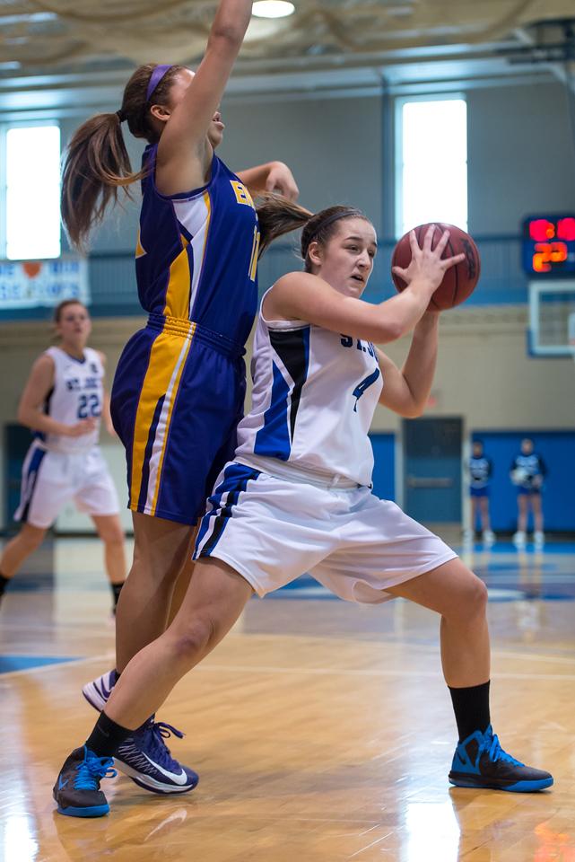 Skyler Makkinje (4) looks to make a during the Women's Basketball game between Saint Joseph's (ME) and Emerson College at Saint Joseph's College, Standish, Maine, USA on February 16, 2013. Photo: Chris Poss