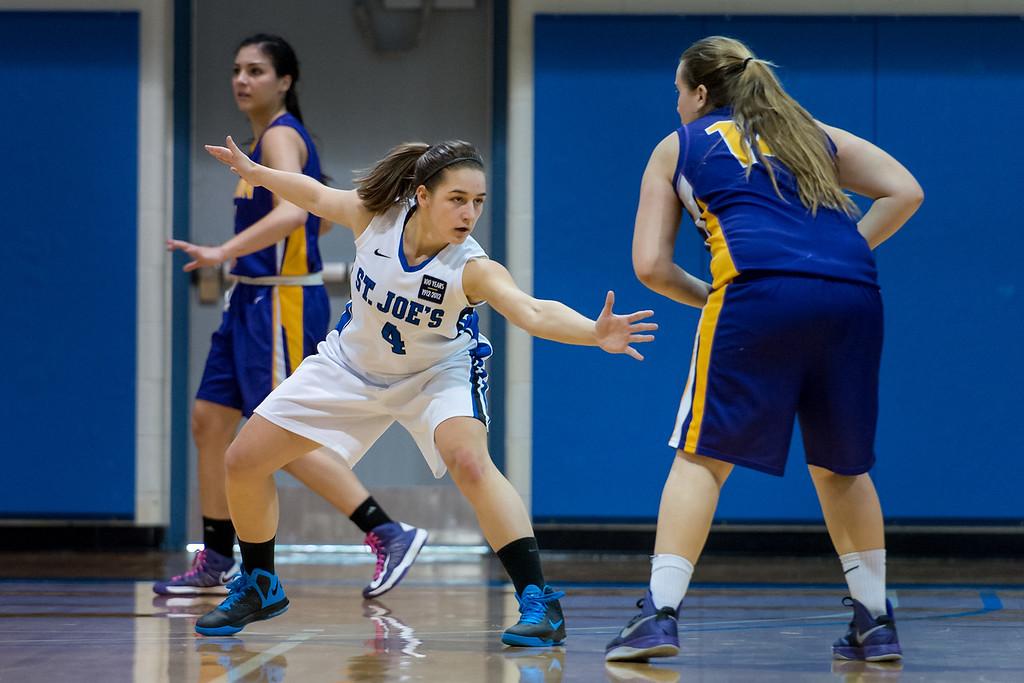 Skyler Makkinje (4) on defense during the Women's Basketball game between Saint Joseph's (ME) and Emerson College at Saint Joseph's College, Standish, Maine, USA on February 16, 2013. Photo: Chris Poss