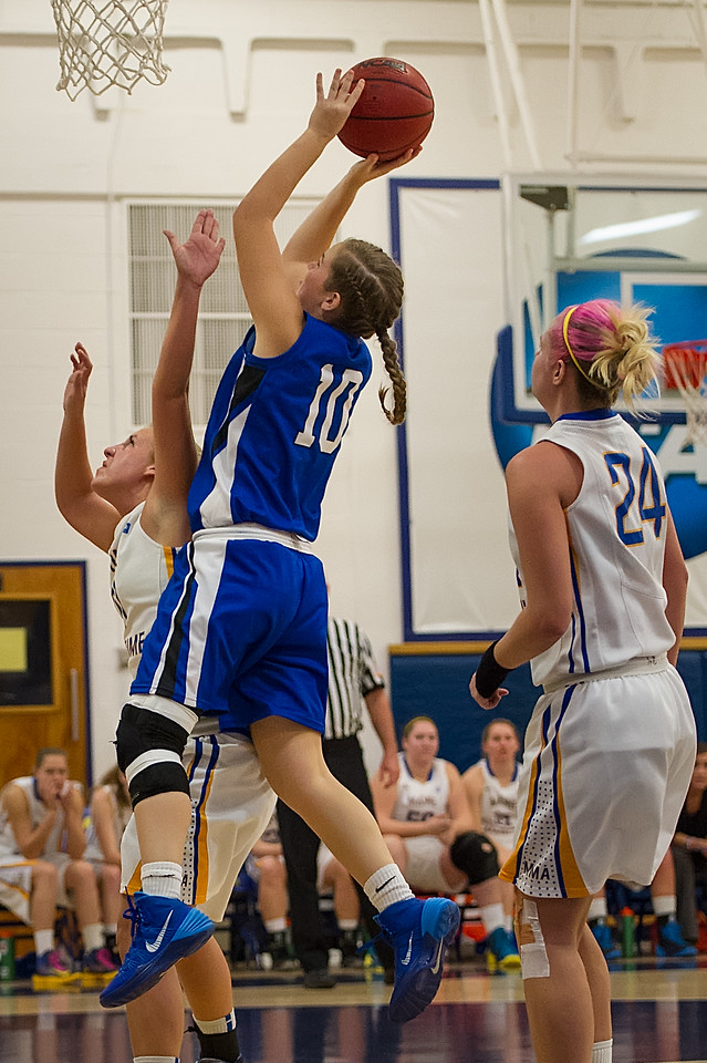 Danica Gleason (10) shoots during the Women's Basketball game between Saint Joseph's (ME) and Maine Maritime Academy at Maine Maritime Academy, Castine, Maine, USA on November 23, 2013. Photo: Chris Poss