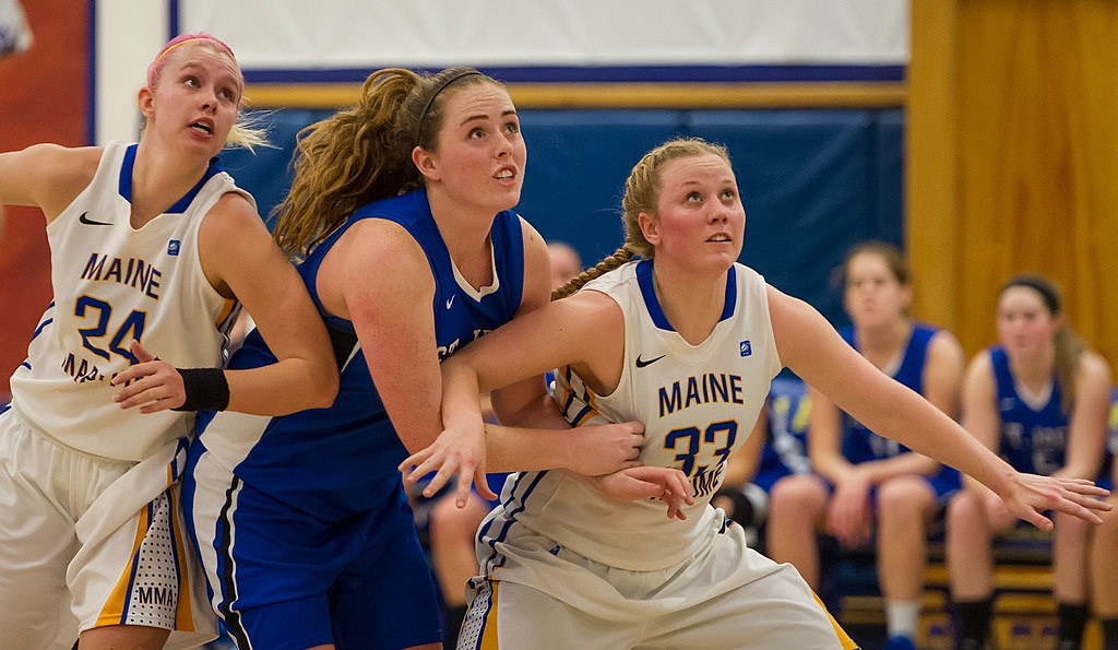 Morgan Cahill (32) fights for rebounding position during the Women's Basketball game between Saint Joseph's (ME) and Maine Maritime Academy at Maine Maritime Academy, Castine, Maine, USA on November 23, 2013. Photo: Chris Poss