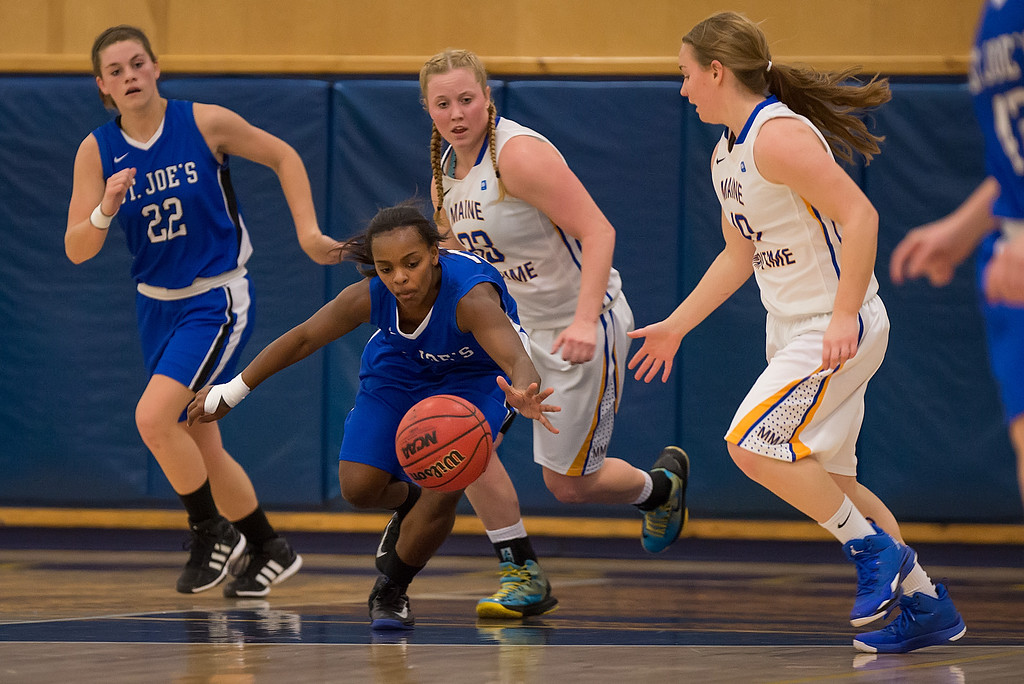 Sarah Assante (20) goes after a loose ball during the Women's Basketball game between Saint Joseph's (ME) and Maine Maritime Academy at Maine Maritime Academy, Castine, Maine, USA on November 23, 2013. Photo: Chris Poss
