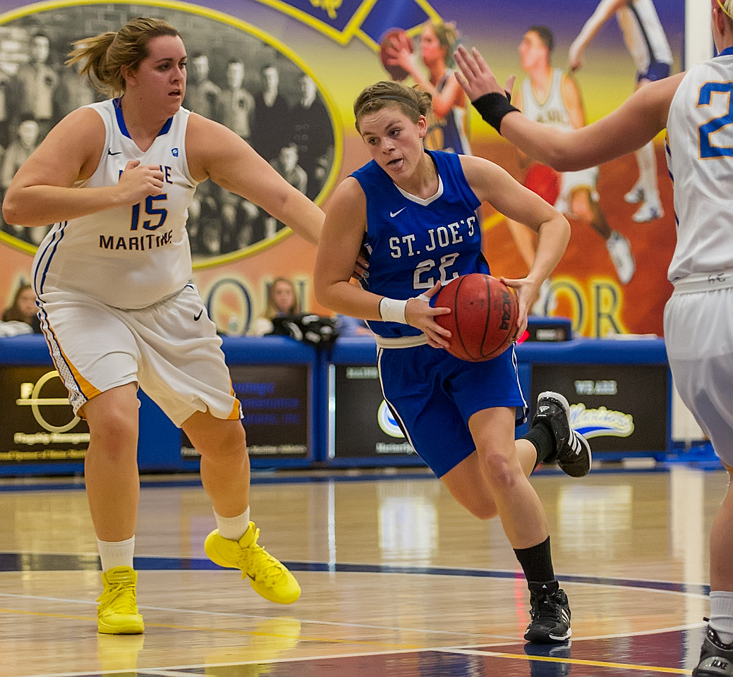 Lindsay Moore (22)  drives down the lane during the Women's Basketball game between Saint Joseph's (ME) and Maine Maritime Academy at Maine Maritime Academy, Castine, Maine, USA on November 23, 2013. Photo: Chris Poss