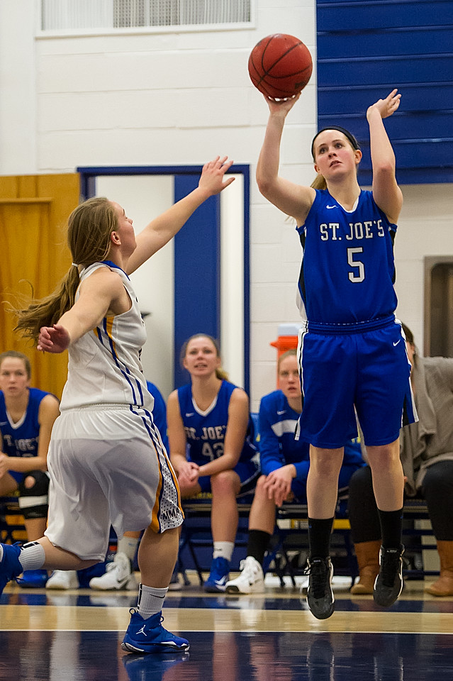 Emily Kehoe (5)  shoots during the Women's Basketball game between Saint Joseph's (ME) and Maine Maritime Academy at Maine Maritime Academy, Castine, Maine, USA on November 23, 2013. Photo: Chris Poss