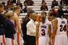 Coach Hillsman talking to his players during a timeout.