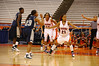 Erica Morrow (21) and Nicole Michael (32) of SU hold off Georgetown's Shanice Fuller (23) and Aminata Diop (54).