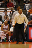 Coach Hillsman reacting to action on the court.