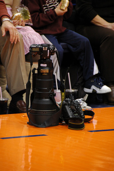Lens lust...400mm f/2.8.  That's a Nikon D300 on the floor next to it.  I believe that's a D2h attached.