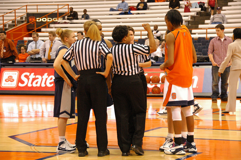 Referees go over game rules with team captains.