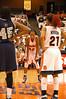 Nicole Michael (32) and Erica Morrow (21) await a free throw attempt by Georgetown.