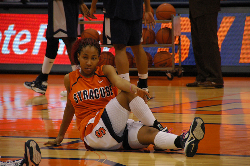 Erica Morrow stretching during pre-game warmup.