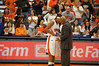 "Coach Quentin Hillsman discussing ""something"" with Chandrea Jones (24)."