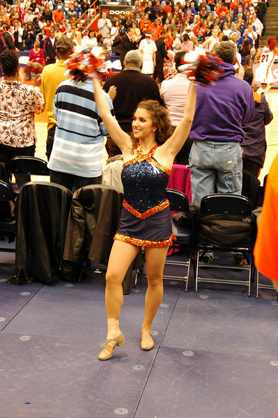 One of the members of the SU Dance Team urges the crowd on to clap.  It is tradition for SU fans to stand and clap  until SU scores their first basket.