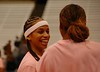 Tracy Harbut sharing a laugh with Chandrea Jones during pre-game workout.