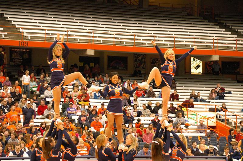 SU cheerleaders doing handstands.