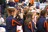 Syracuse University's Athletic Director Daryl Gross high fives members of SU women's athletics during a half-time ceremony honoring them.