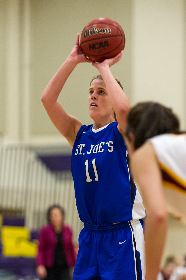 Molly Mack (11) shoots a free throw during the Women's Basketball game between Saint Joseph's (ME) and Saint John Fisher at Curry College, Milton, Massachusetts, USA on November 15, 2013. Photo: Chris Poss