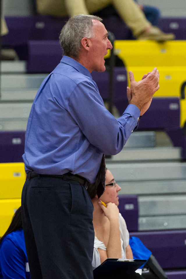 Head Coach Mike McDevitt rallies the team during the Women's Basketball game between Saint Joseph's (ME) and Saint John Fisher at Curry College, Milton, Massachusetts, USA on November 15, 2013. Photo: Chris Poss