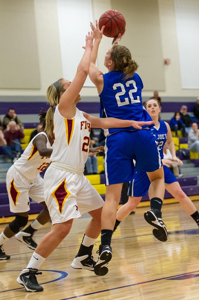 Lindsay Moore (22) shoots during the Women's Basketball game between Saint Joseph's (ME) and Saint John Fisher at Curry College, Milton, Massachusetts, USA on November 15, 2013. Photo: Chris Poss