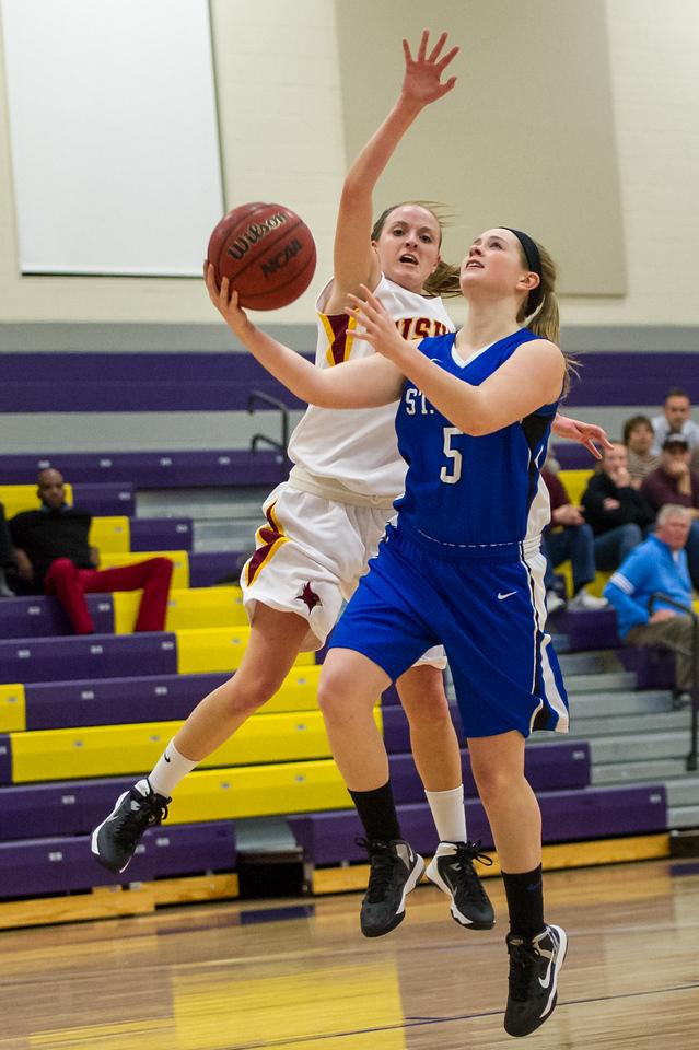 Emily Kehoe (5) shoots during the Women's Basketball game between Saint Joseph's (ME) and Saint John Fisher at Curry College, Milton, Massachusetts, USA on November 15, 2013. Photo: Chris Poss