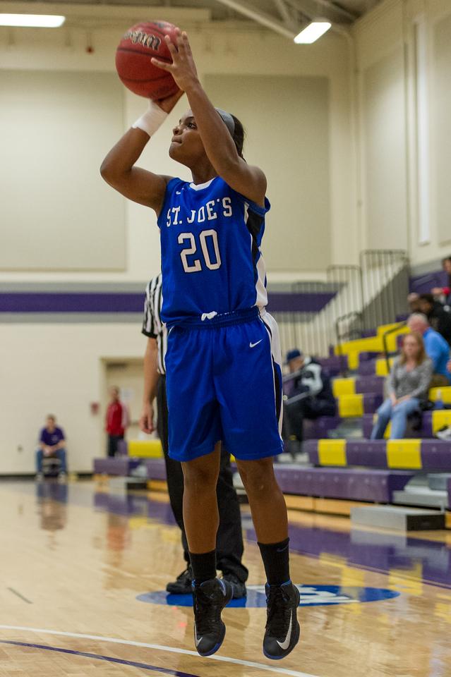 Sarah Assante (20) shoots a jump shot during the Women's Basketball game between Saint Joseph's (ME) and Saint John Fisher at Curry College, Milton, Massachusetts, USA on November 15, 2013. Photo: Chris Poss