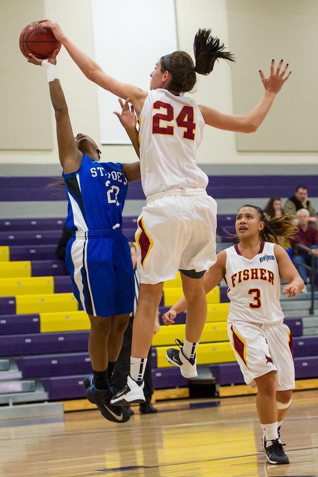 Sarah Assante (20) has her shot blocked during the Women's Basketball game between Saint Joseph's (ME) and Saint John Fisher at Curry College, Milton, Massachusetts, USA on November 15, 2013. Photo: Chris Poss