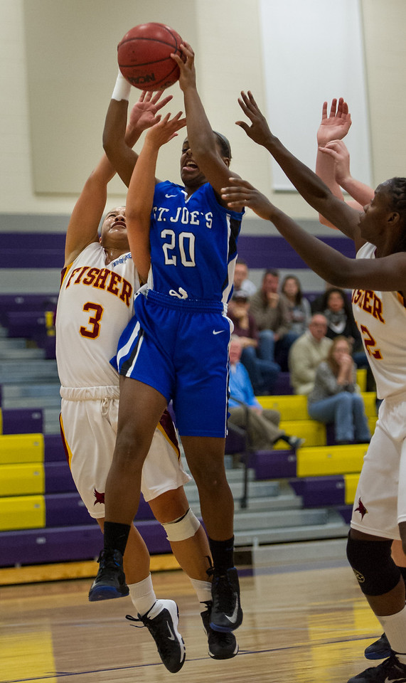 Sarah Assante (20) grabs a rebound during the Women's Basketball game between Saint Joseph's (ME) and Saint John Fisher at Curry College, Milton, Massachusetts, USA on November 15, 2013. Photo: Chris Poss