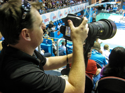 Gold Coast Blaze Official Photographer Scott Belzner with the heavy Nikon Telephoto Glass. Game v Adelaide 36ers, Friday 23 December 2011. Photo by Des Thureson - http://disci.smugmug.com