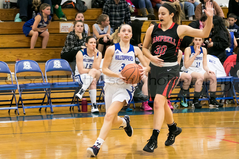 Somersworth's Jaiden Croteau, left, drives to the hoop while being defended by Cambpell's Emma Rousseau, right, during Division III basketball action in Somersworth Friday. [Photo by Scott Patterson/Fosters.com]
