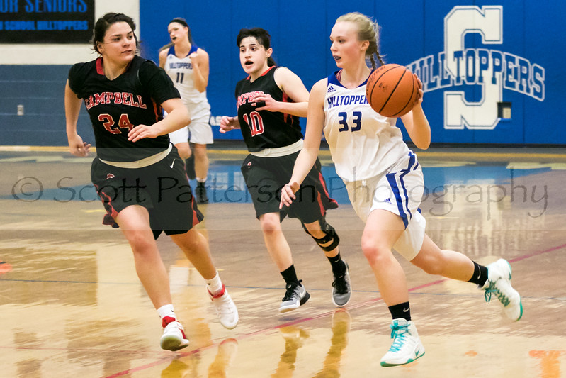 Somersworth's Jordan Wall,  right, dribbles up the court while being defended by Cambpell's Jaelyn Lavigne, left, and Brittany Reidy, center, during Division III basketball action in Somersworth Friday. [Photo by Scott Patterson/Fosters.com]
