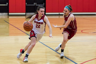 Spaulding's Brooke Clooney, left, drives to the basket while being defended by Concord's Ashley Kelley, right, during DIV I action Friday in Rochester. [Scott Patterson/Fosters.com]