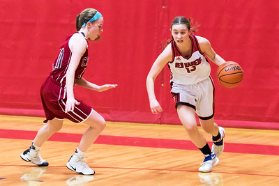 Spaulding Freshman Mary Paradis, right, drives to the basket while being defended by Concord's Caitlyn Kelley, left, during DIV I action Friday in Rochester. [Scott Patterson/Fosters.com]