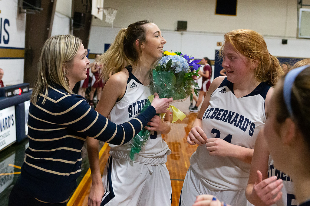 . St. Bernard\'s Sabrina Patton, center, celebrates with her team after scoring her 1,000th career varsity point in a 58-28 win over visiting Fitchburg on Saturday, Jan. 26, 2019. SENTINEL & ENTERPRISE / GARY FOURNIER